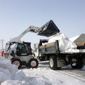 Hauling snow from sites